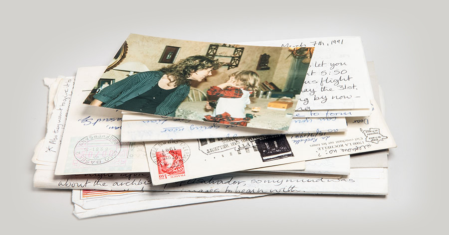 Pile of old letters, postcards and family photos.