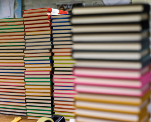 Stacks of colourful hand-bound notebooks