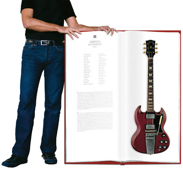 Giant book of photos of life size guitars