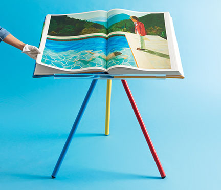 Art book on colourful stand