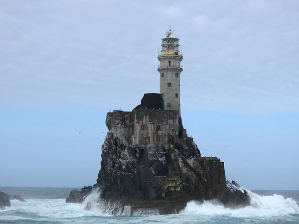 Fastnet lighthouse on a lonely rock in high seas