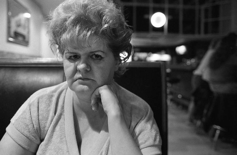 sad-looking woman in bar