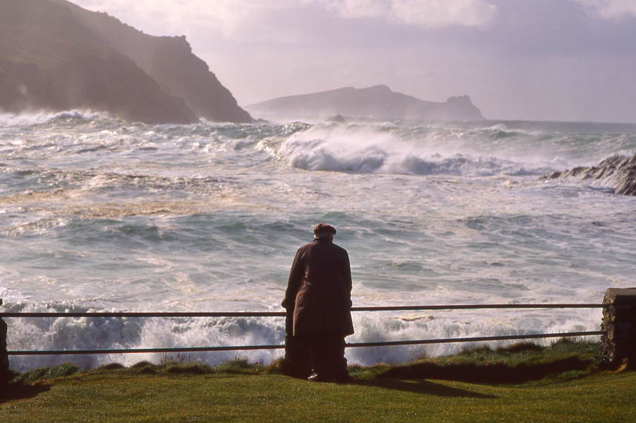 man looking over stormy sea