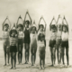 1926 photo of people stretching on the beach